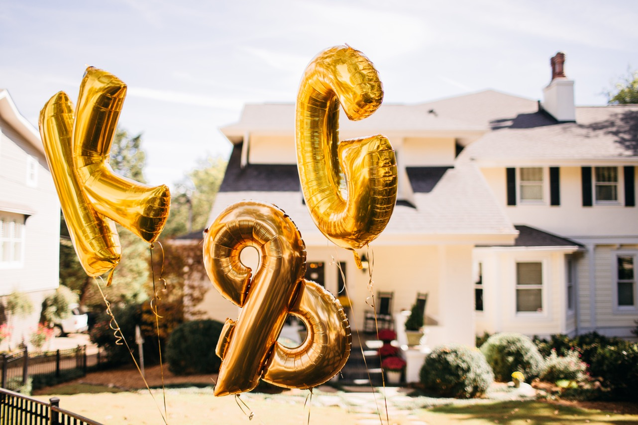 """Gold balloons spelling out """"K & C"""" outside of Hunter Museum."""