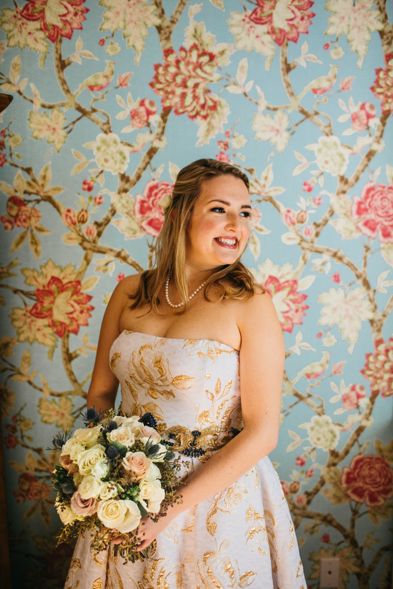 Bride holds her bouquet and smiles at her wedding at Hunter Museum.