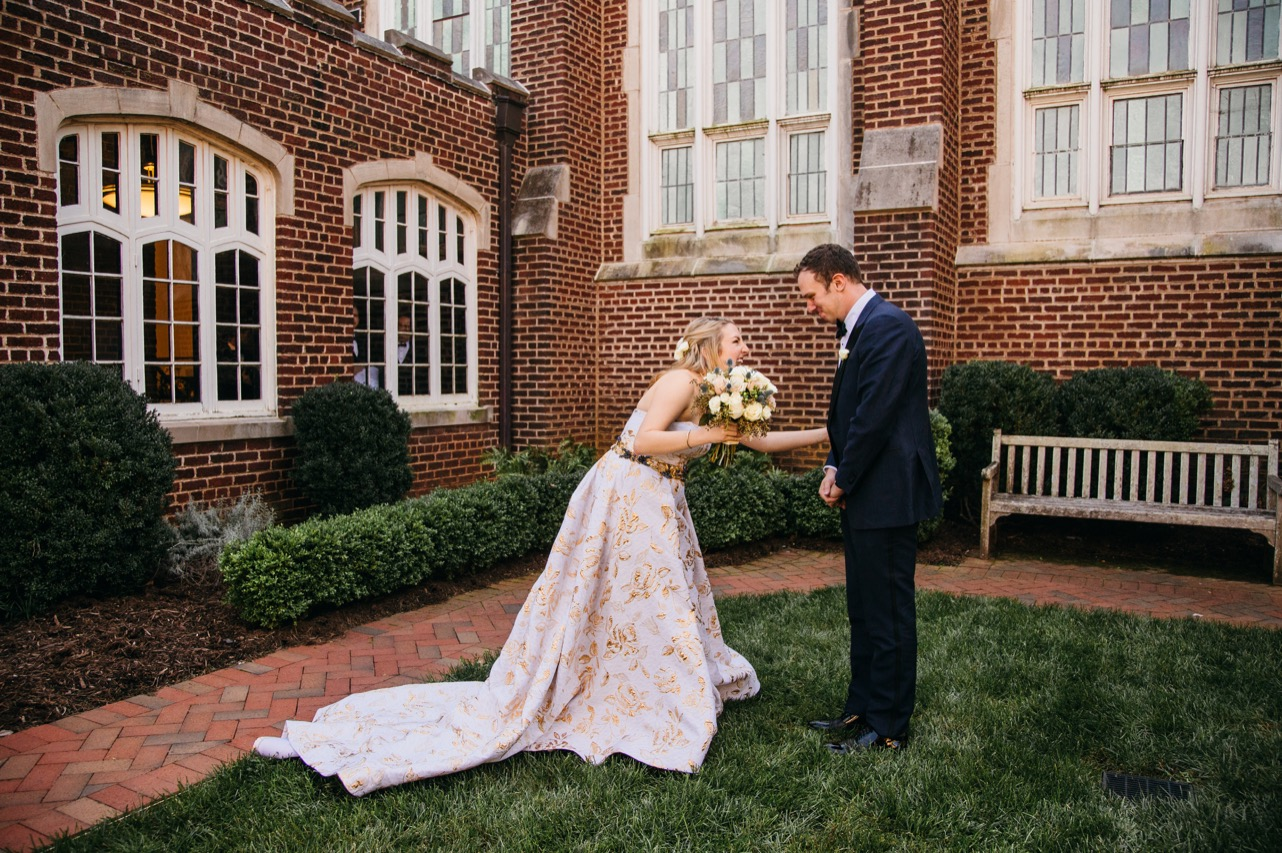 Bride and groom smile during their first look outside the Hunter Museum.
