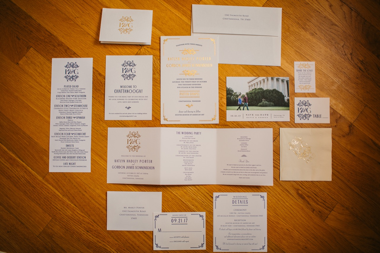 A flatlay of an invitation suite for a wedding at Hunter Museum.