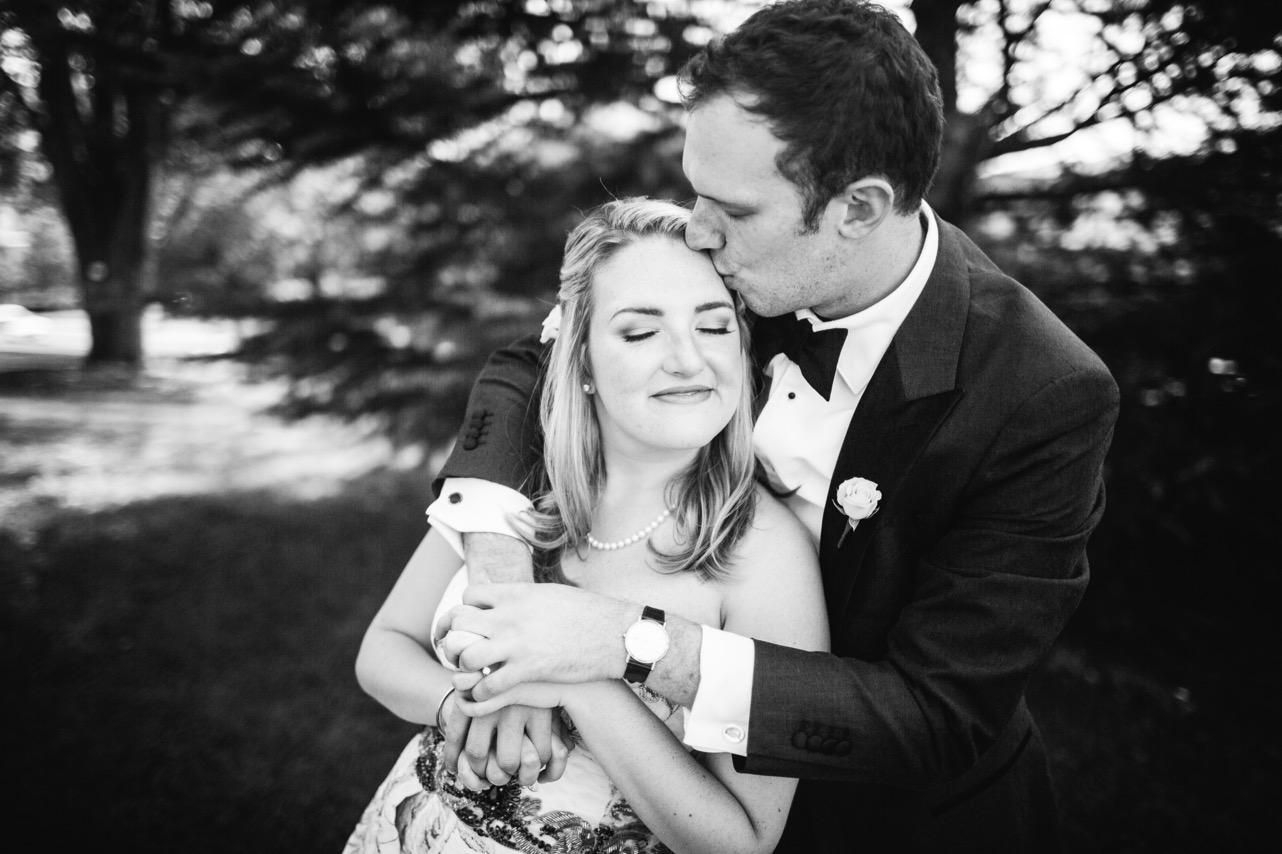 Groom kisses bride on forehead outside the Hunter Museum.