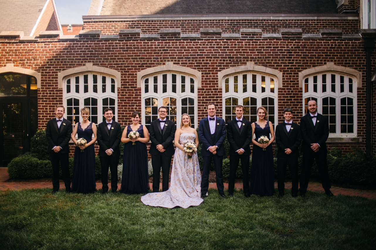 Bride and groom smile as they stand next to their wedding party at their Hunter Museum wedding.