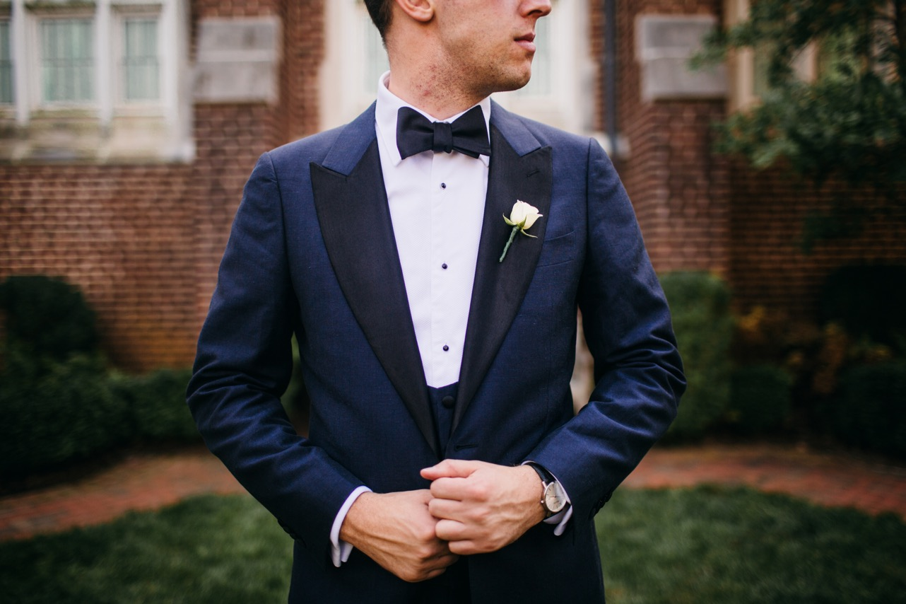 Details of the grooms navy blue suit are shown for the wedding at the Hunter Museum.