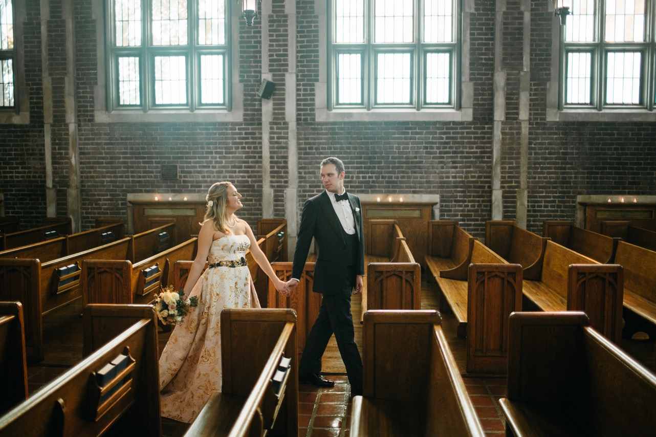 Bride and groom smile as they walk down the aisle of the chapel at their Hunter Museum wedding.