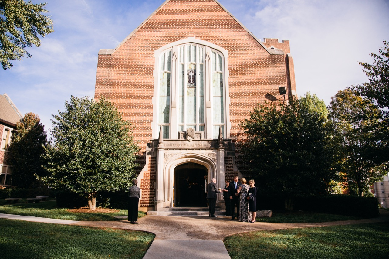 Family and friends stand outside the chapel at the wedding at Hunter Museum.