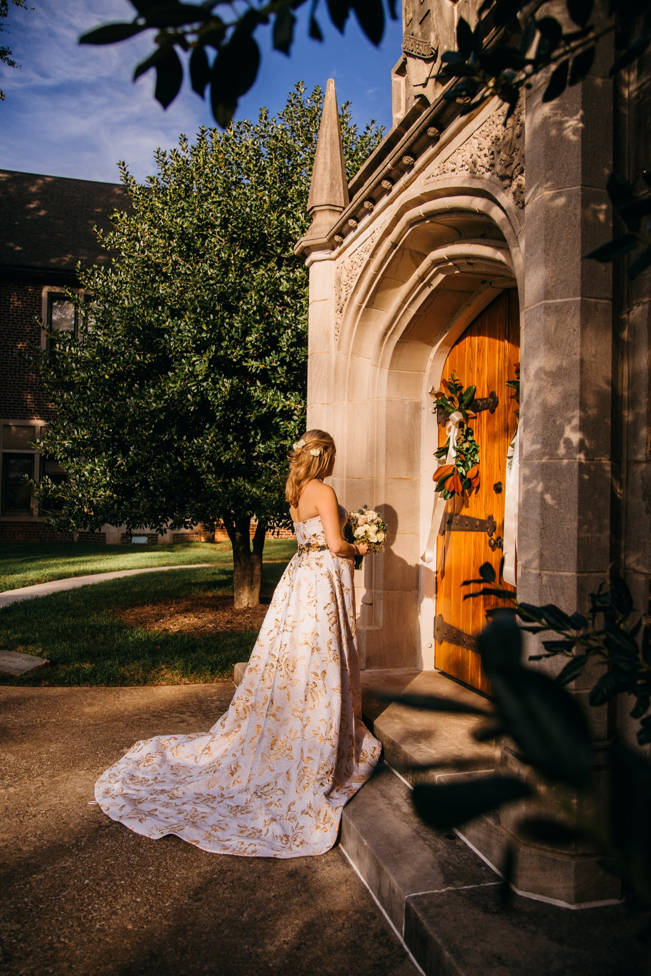 Bride stands outside the chapel of her wedding at the Hunter Museum.