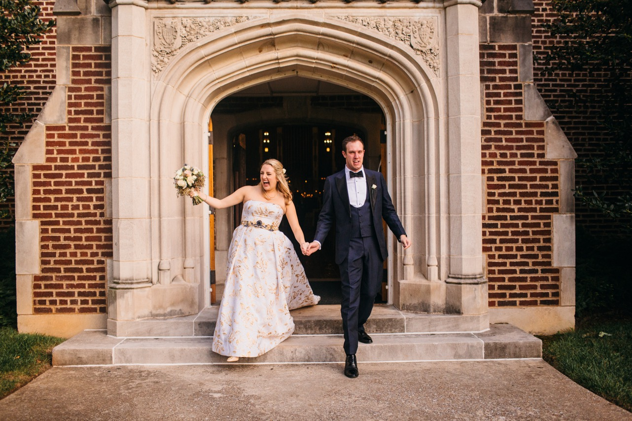 Bride and groom walk down the steps of the chapel at their Hunter Museum wedding.