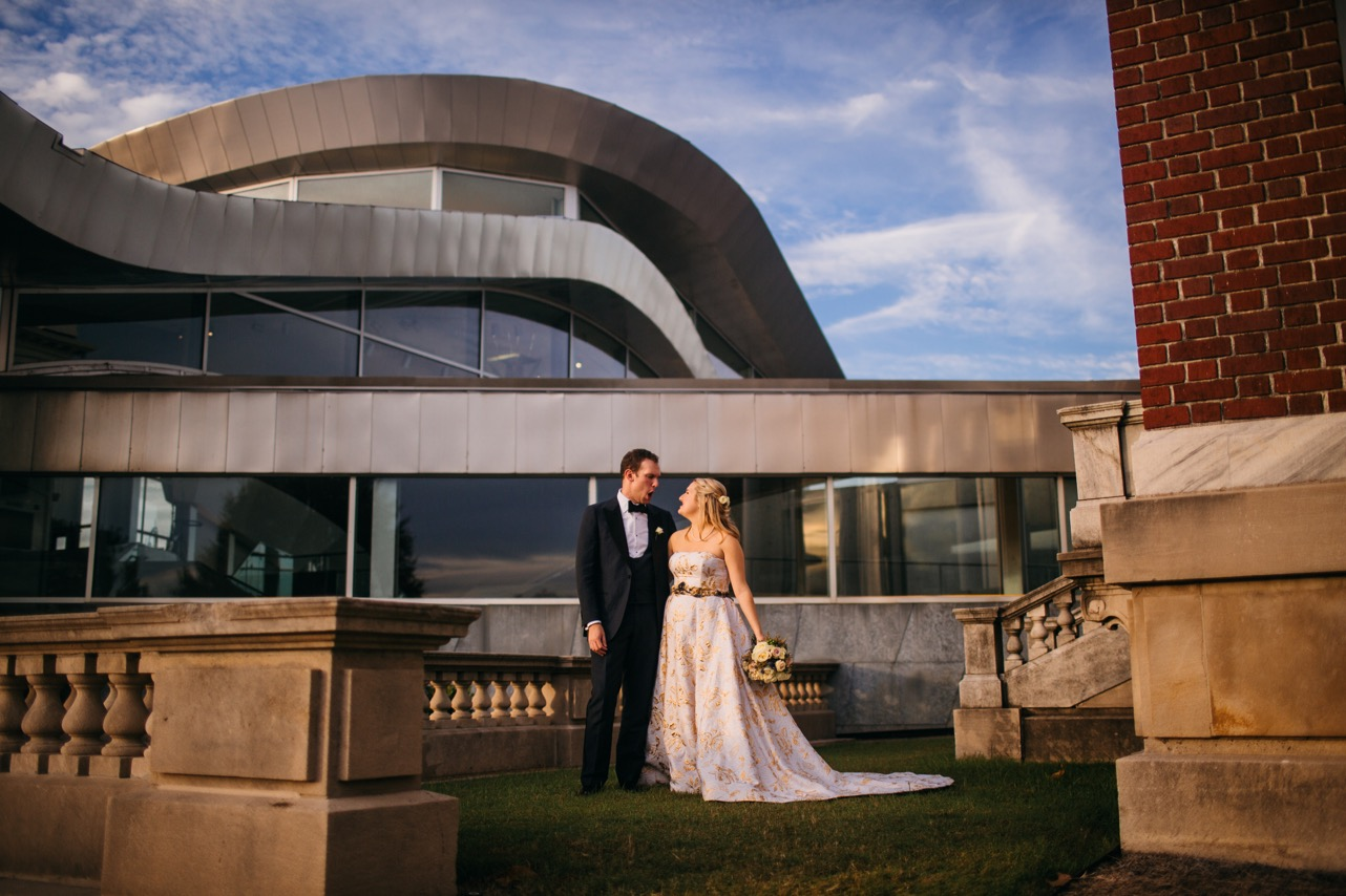 Bride and groom walk down the steps outside their reception of their Hunter Museum wedding.