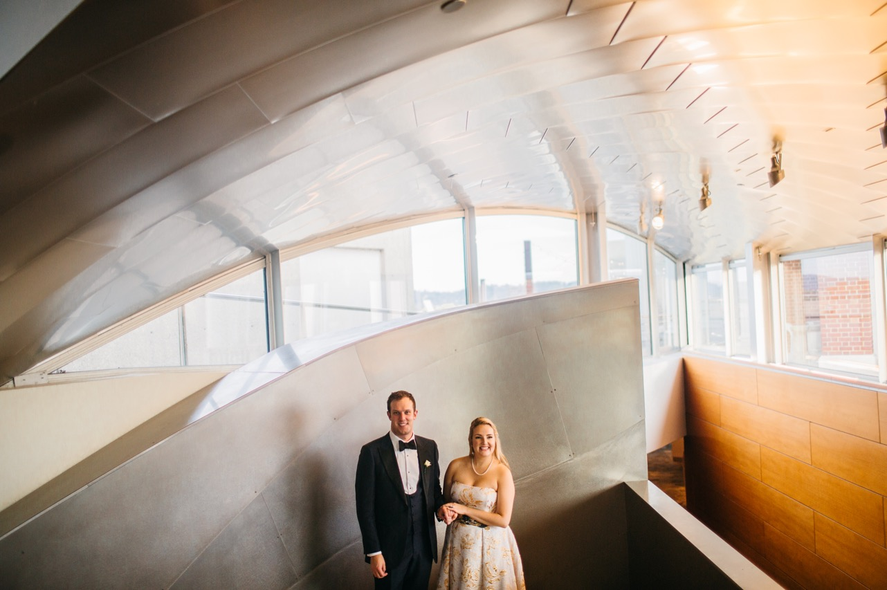 Bride and groom hold hands at their Hunter Museum wedding.