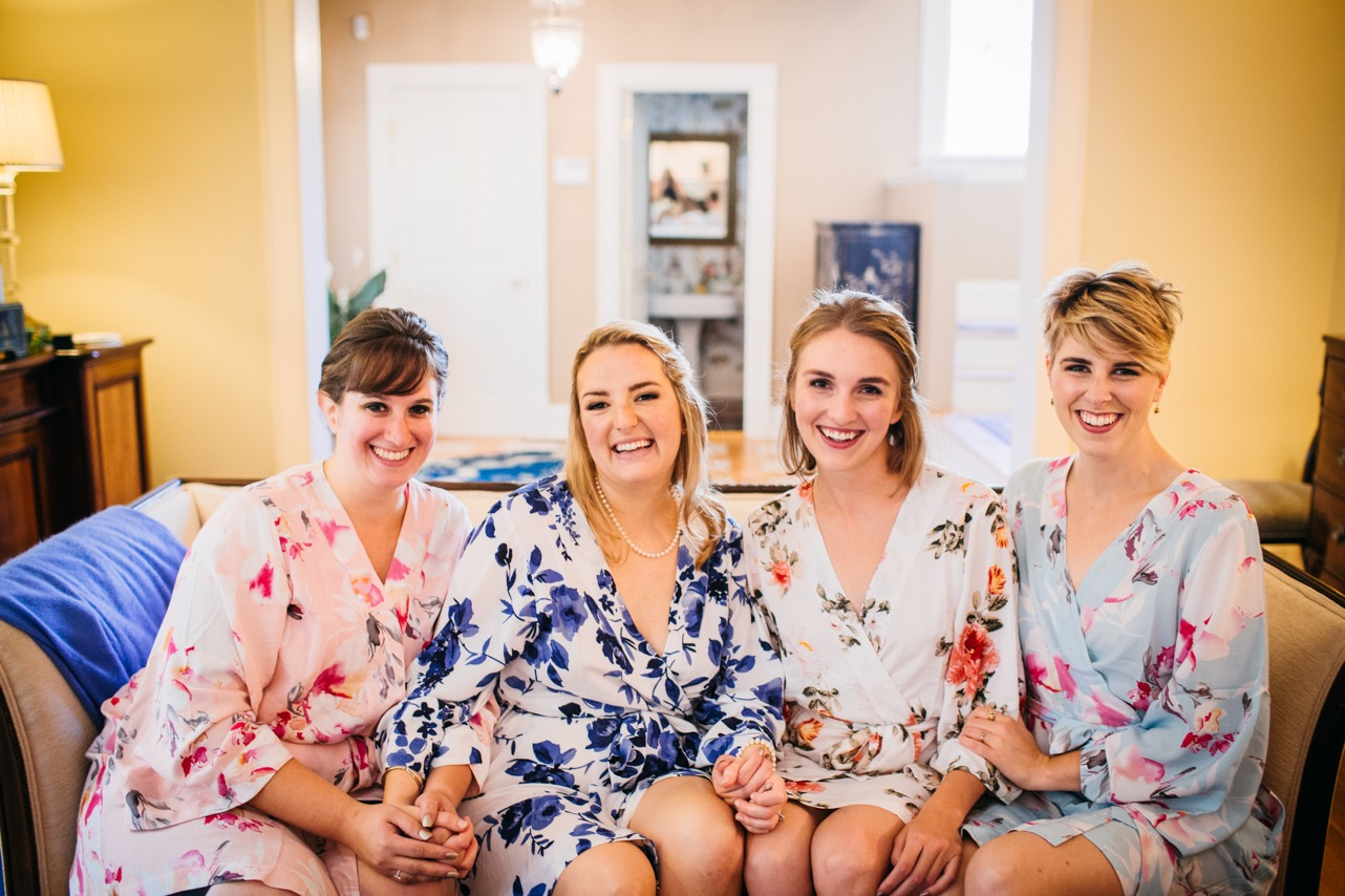 Bride and bridesmaids smile for a photo for a wedding at Hunter Museum