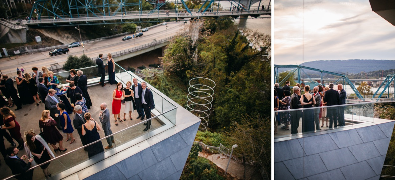 Family and friends mingle on the balcony during the reception at the wedding at Hunter Museum.