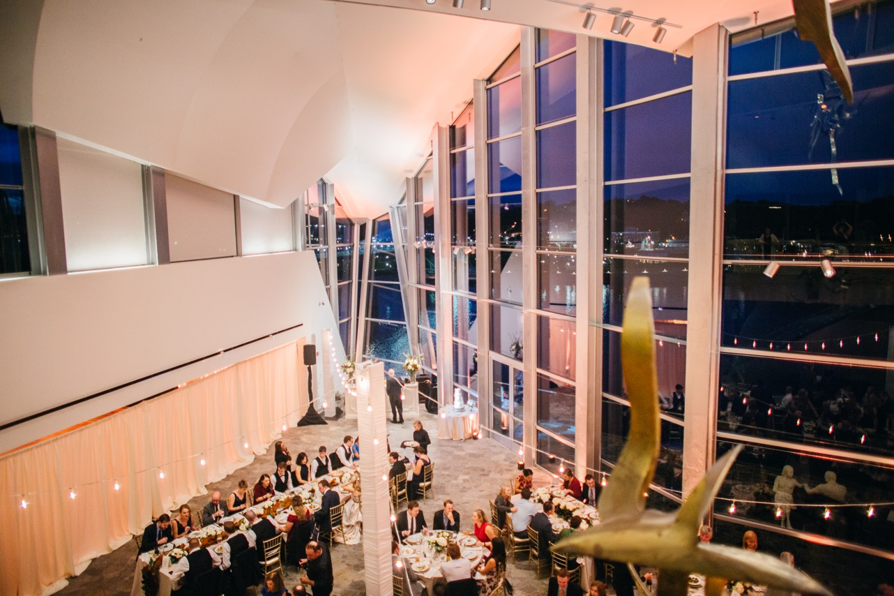 Friends and family mingle as they eat during the reception of the wedding at Hunter Museum.