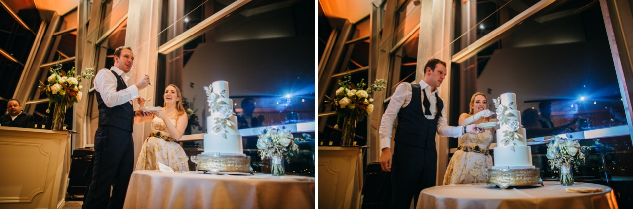 Bride and groom cut into their cake at their wedding at the Hunter Museum.