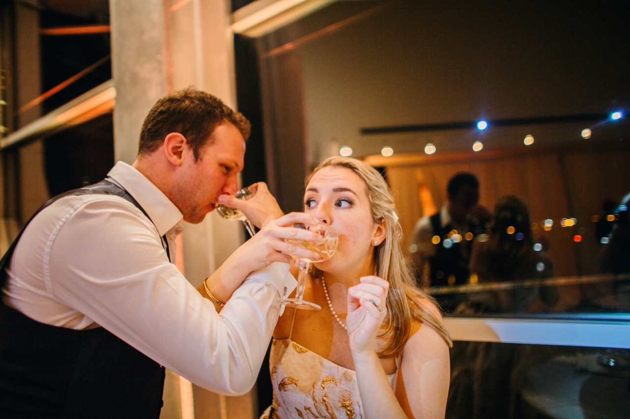 Bride and groom eat a slice of cake during the reception of their wedding at the Hunter Museum.
