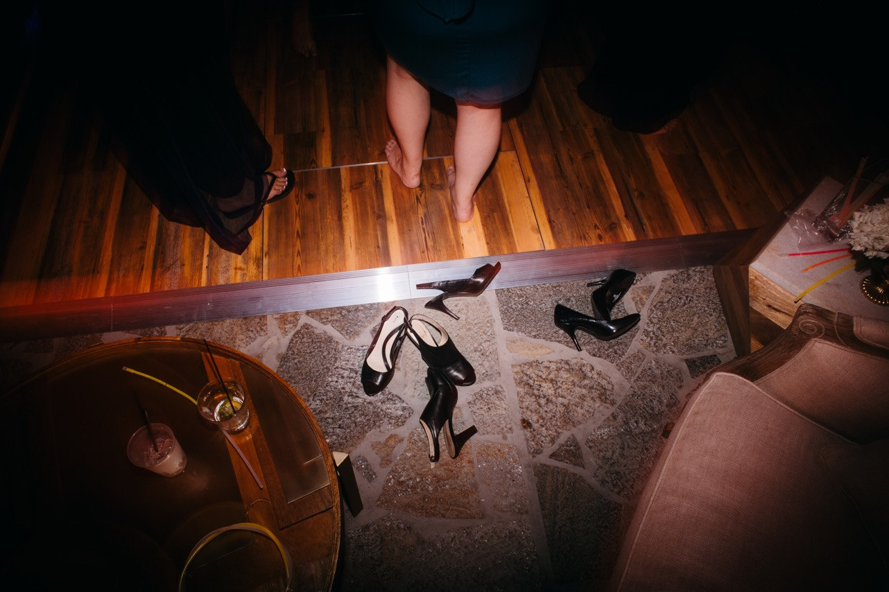 Guests kick off their shoes during the wedding at the Hunter Museum.