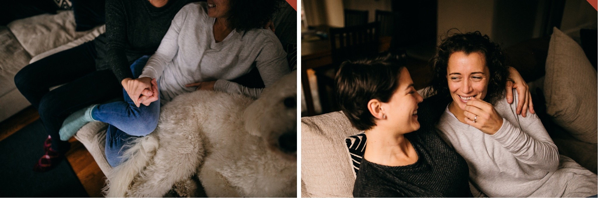 A lesbian couple cuddles on the couch with their dog.