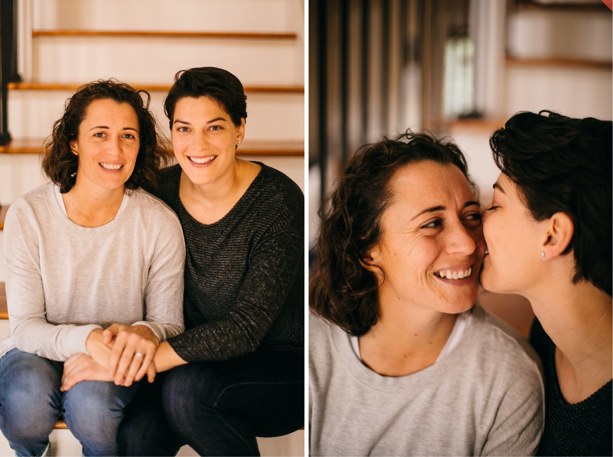 A lesbian couple poses for engagement photos on a staircase.