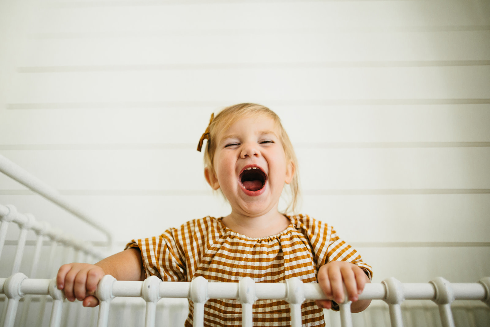 Sweet little girl dancing and screaming in her crib for their family photos!