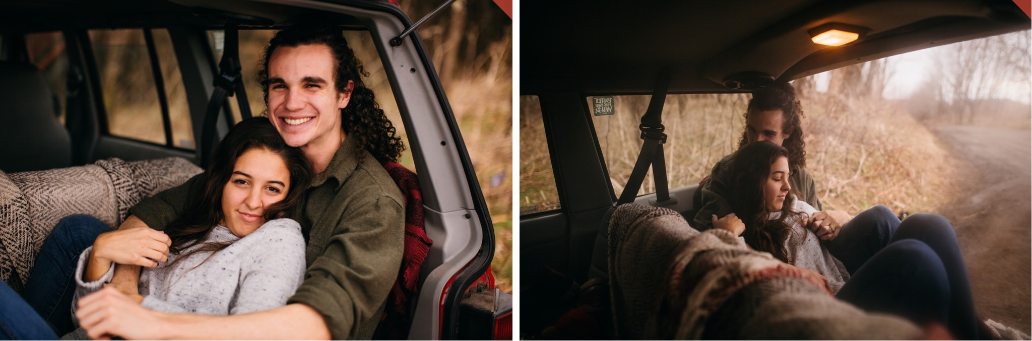 A couple snuggle together in blankets in the back of a red Jeep Cherokee.