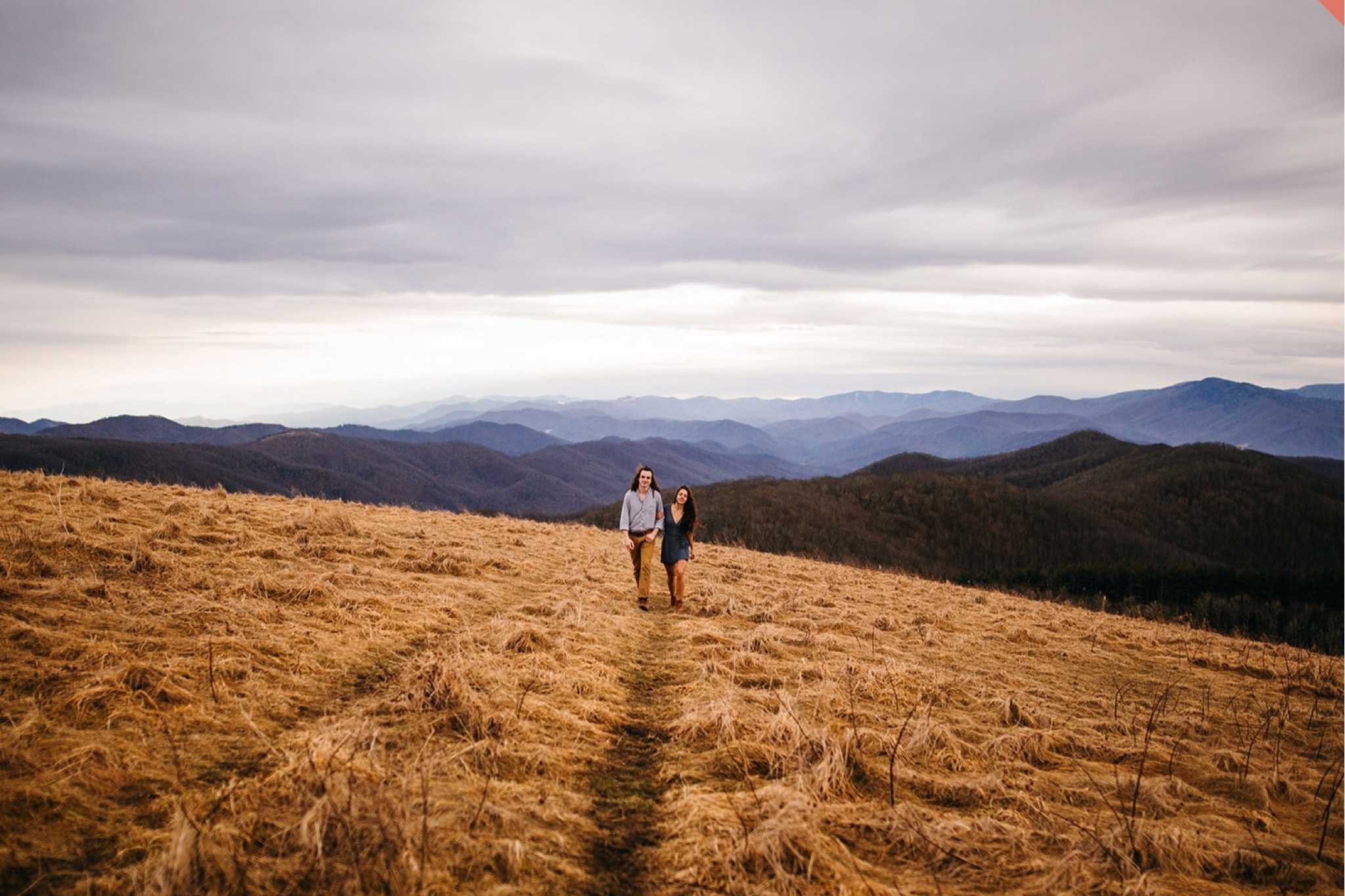A couple embraces at the top of Max Patch in North Carolina.
