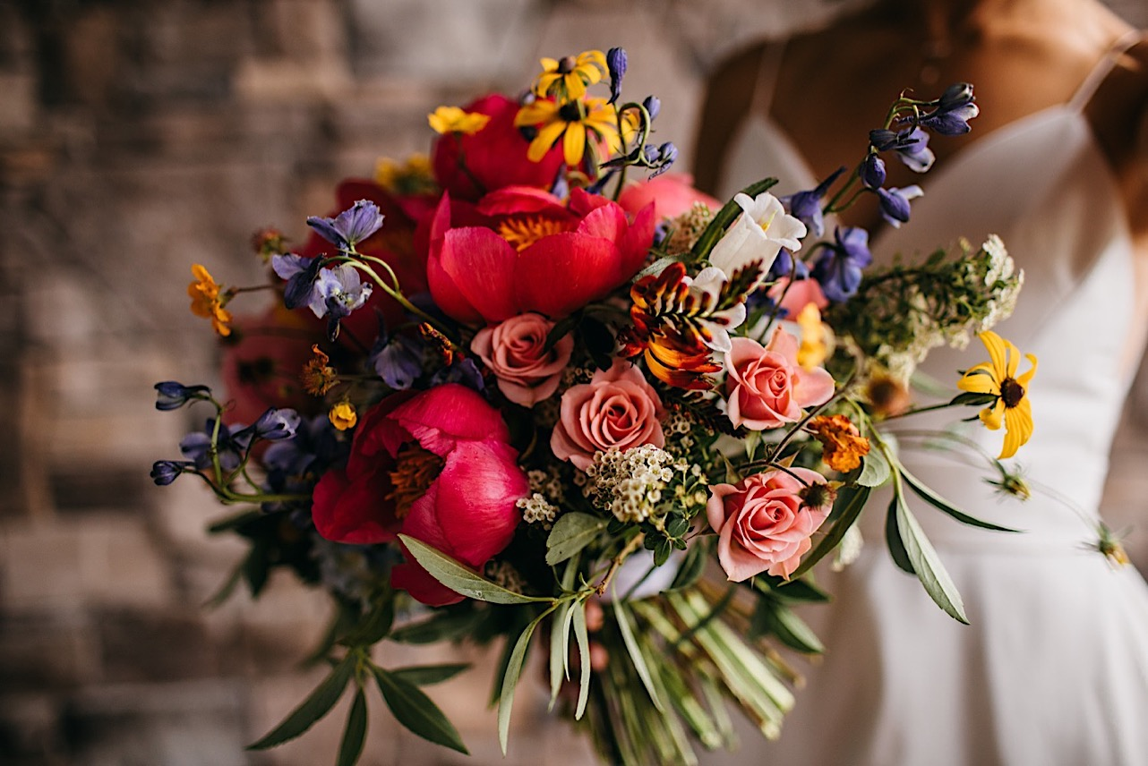 Emily Kaye Designs bright and whimsical bridal bouquet with pink, red, purple and yellow flowers