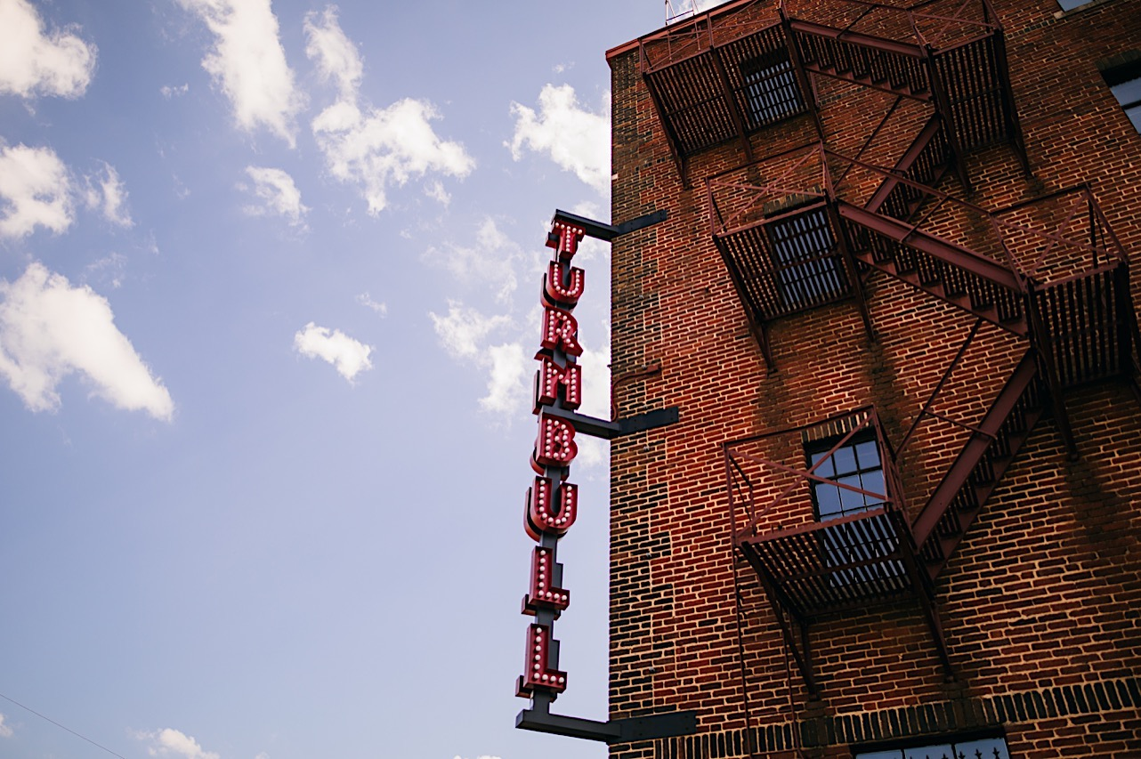 The Turnbull Building red marquee sign and metal fire escape staircases on brick exterior in downtown Chattanooga