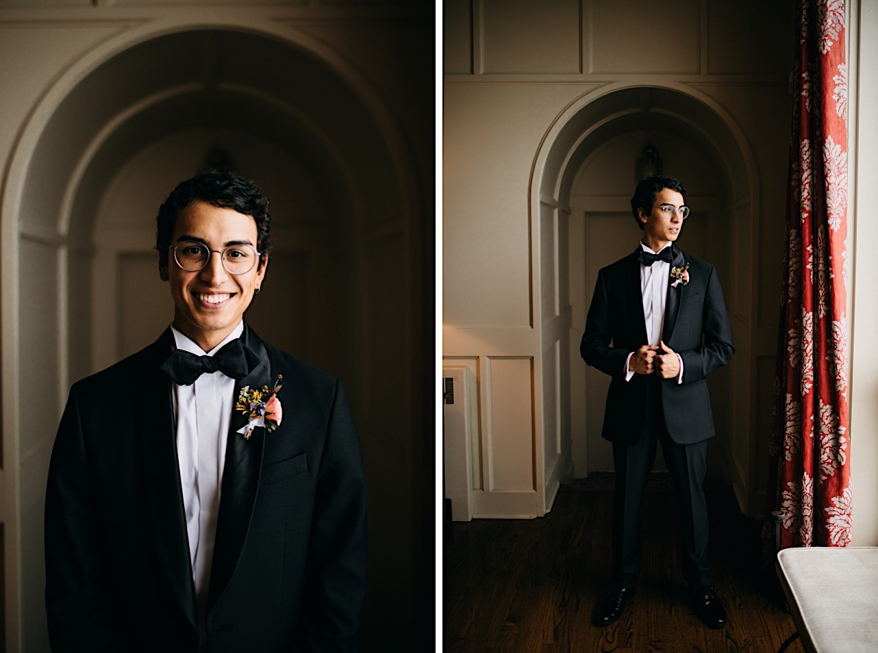 groom stands in arched doorway near bright window smiling
