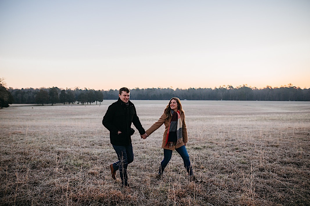 Chattanooga couple walking through frosty field at Chickamauga Battlefield
