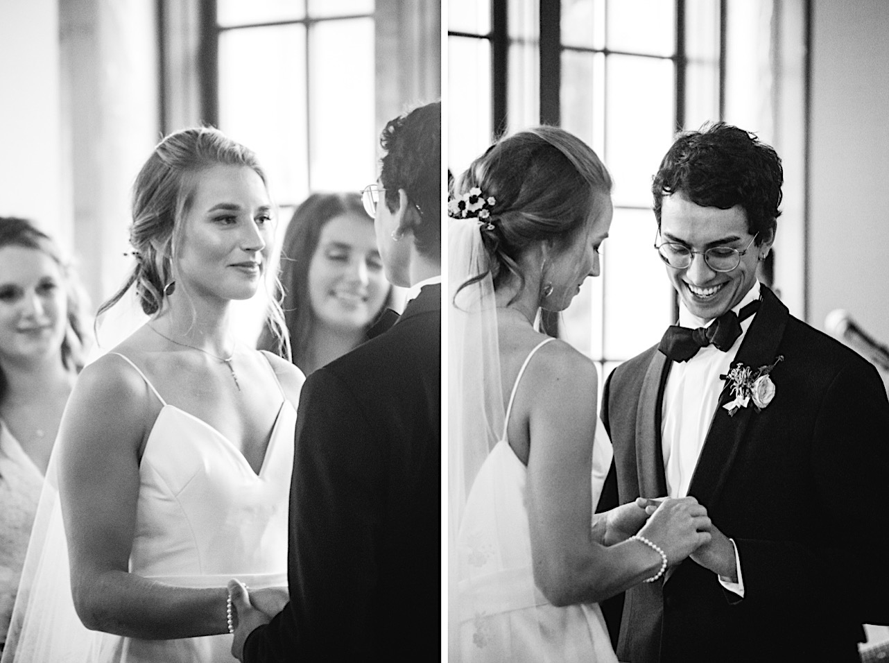 bride and groom smile at each other while she slides a wedding band onto his finger