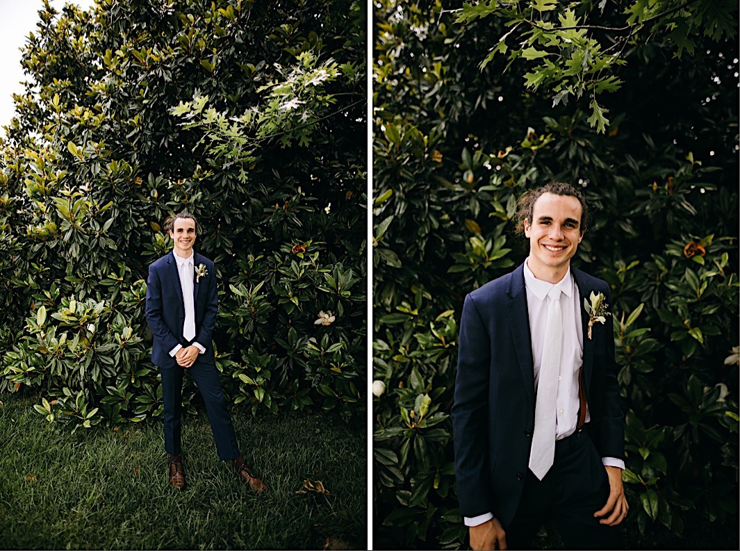 groom smiles in front of a large magnolia tree on Lookout Mountain near Chattanooga, TN
