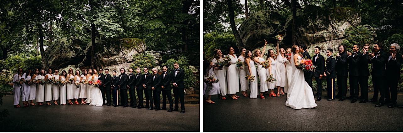 bride and groom and wedding party stand in a line between large rock formations at the Lookout Mountain Club on Lookout Mountain Georgia