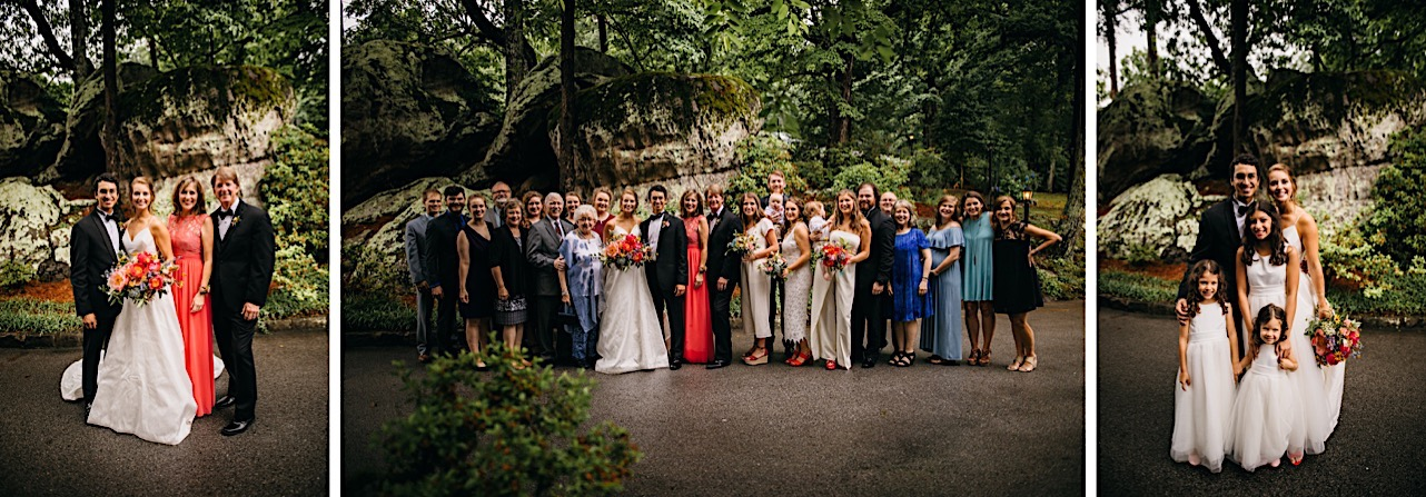 bride and groom and their families stand in front of large rock formations for photos