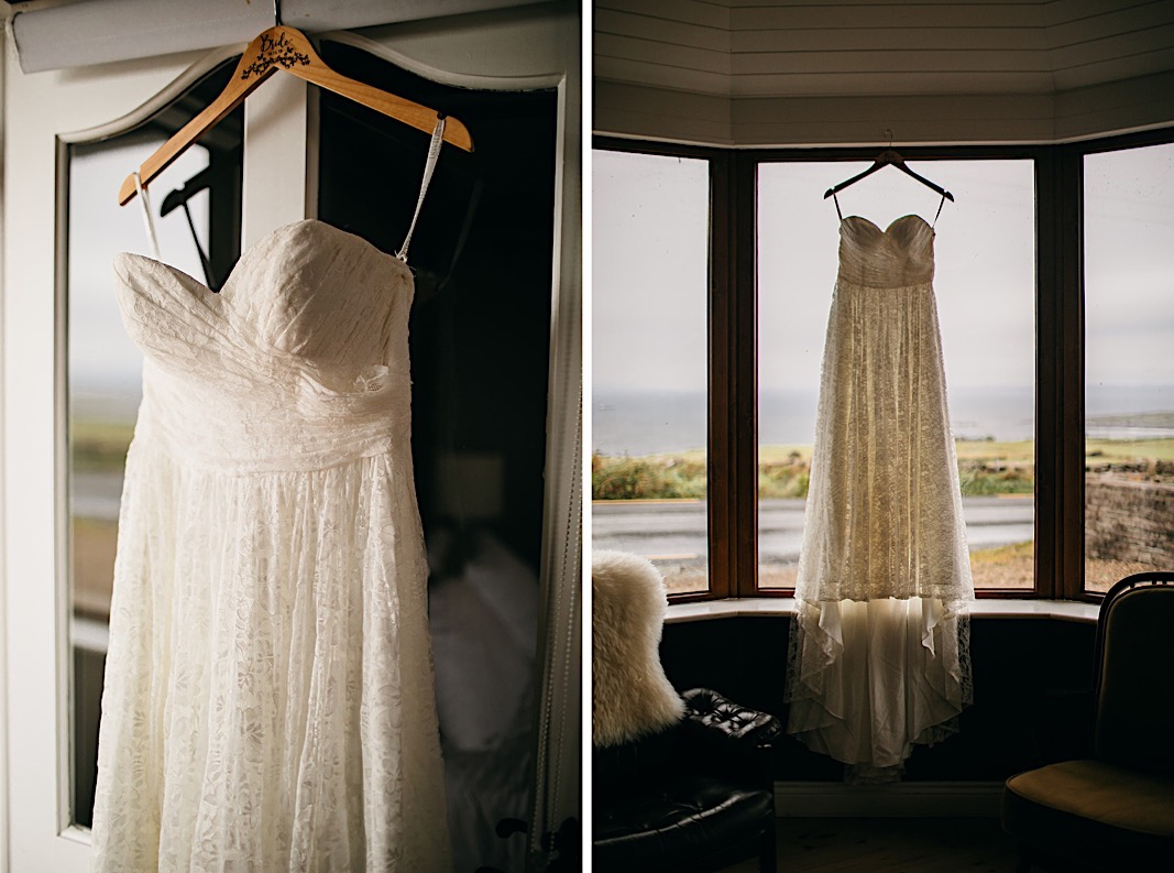 Bride's strapless dress hangs in front of a window