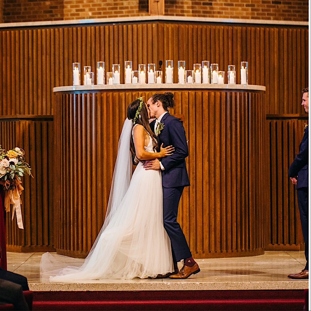 bride and groom share their kiss at First Baptist Church in Chattanooga, TN