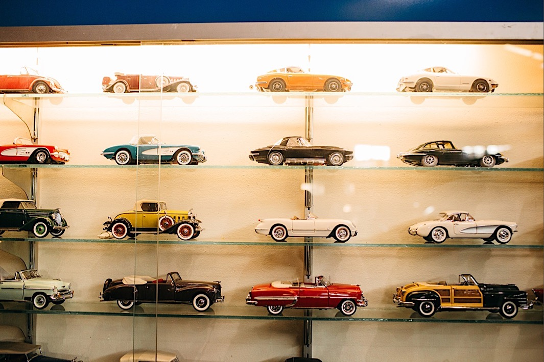 vintage toy cars in a glass window display