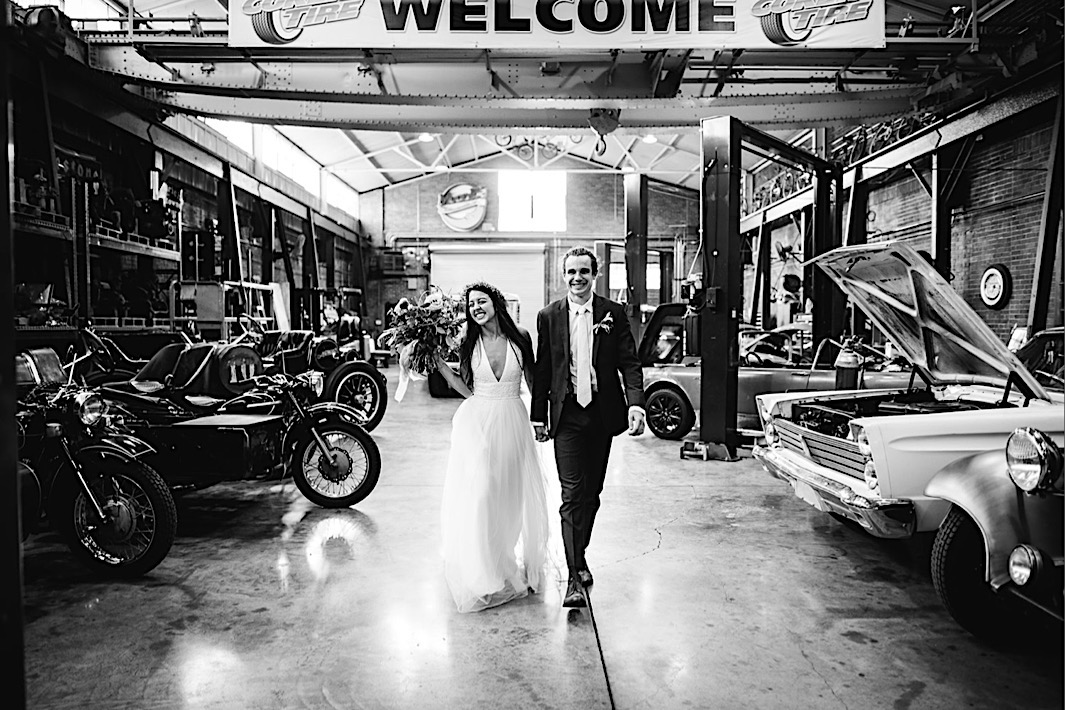 bride and groom portraits between vintage cars and motorcycles at The Coker Museum in downtown Chattanooga, TN