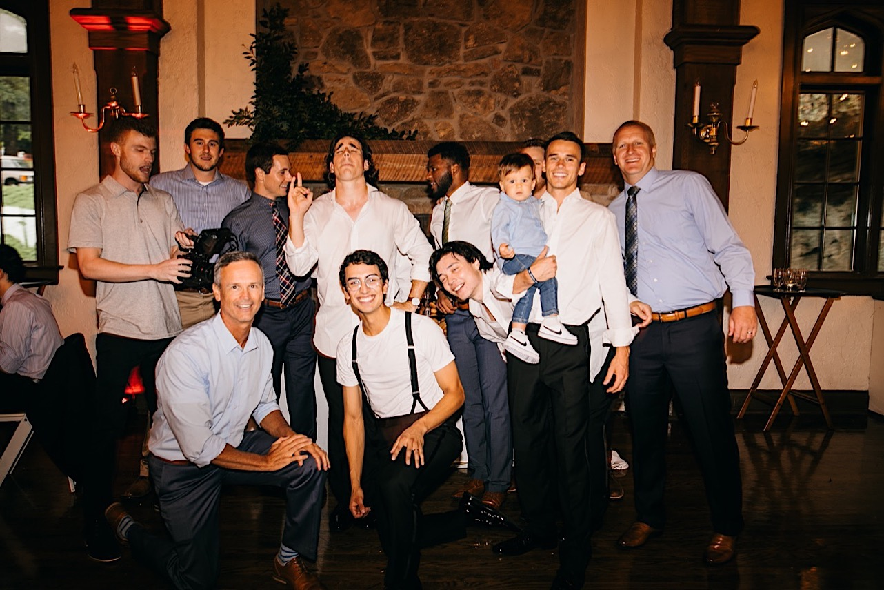 groom and several friends pose for a photo together during Lookout Mountain Club wedding reception