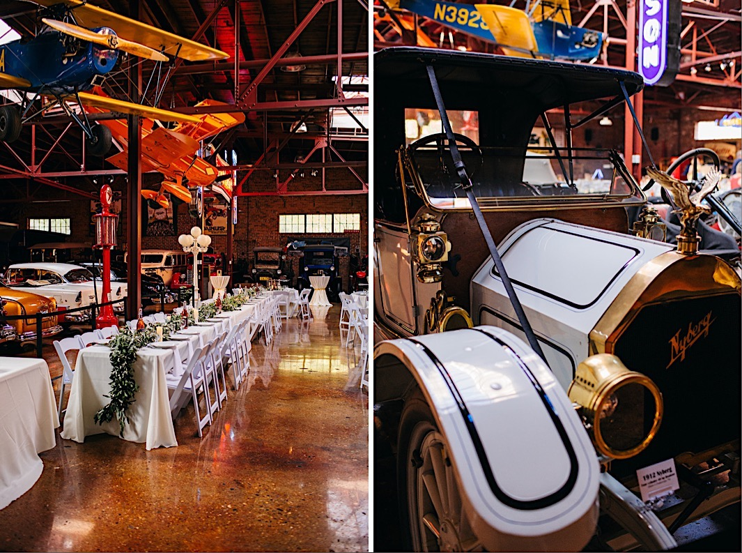 long dining tables covered in white cloths and greenery sit between vintage cars and The Coker Museum in Chattanooga, TN