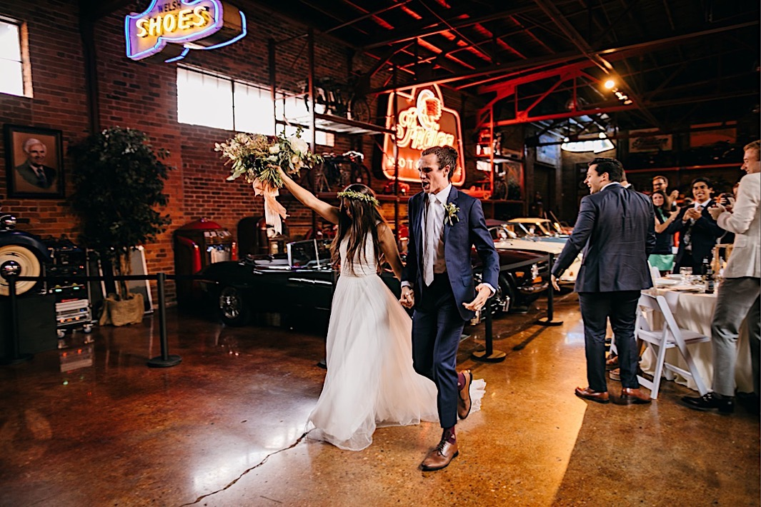 bride and groom enter their reception at downtown Chattanooga's The Coker Museum