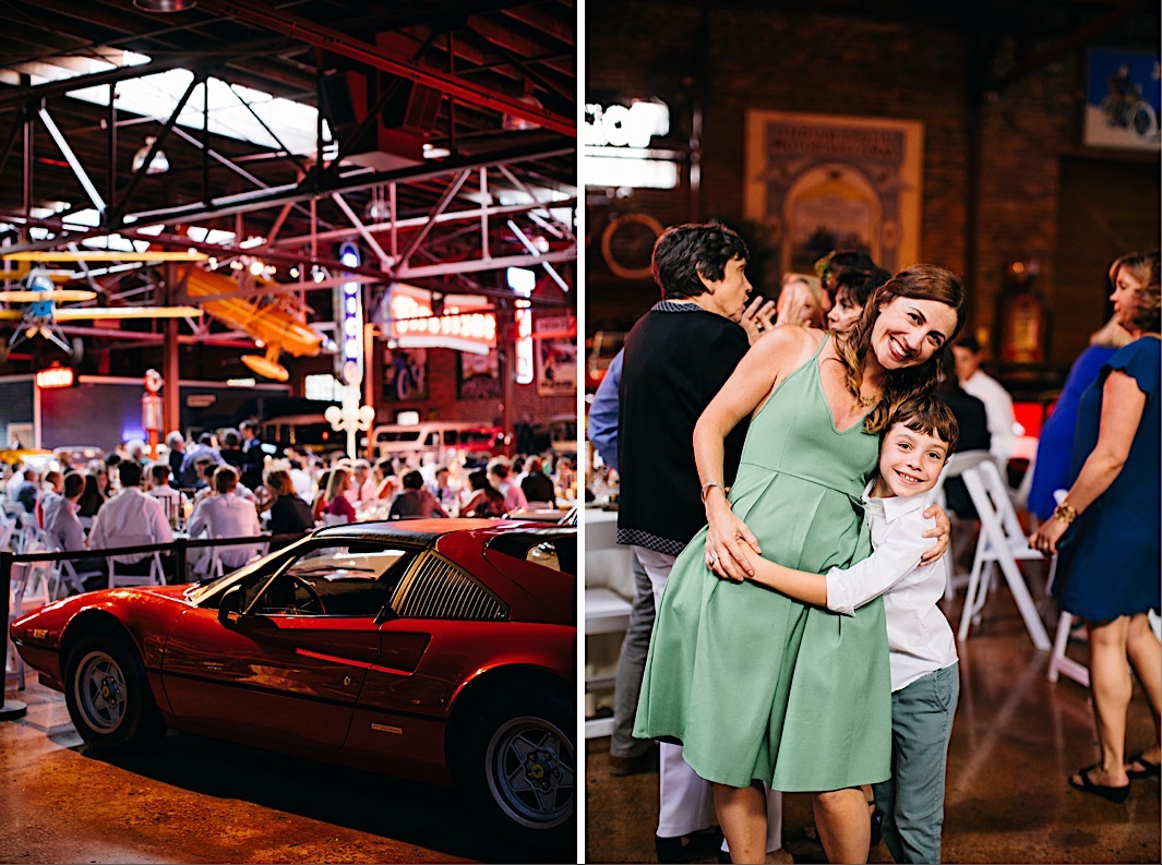wedding guests hug near vintage cars at The Coker Museum wedding reception in Chattanooga, Tennessee