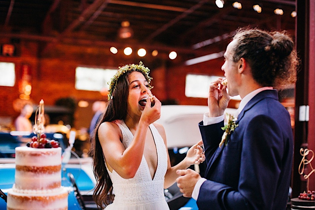 bride and groom feed themselves a bite of wedding cake