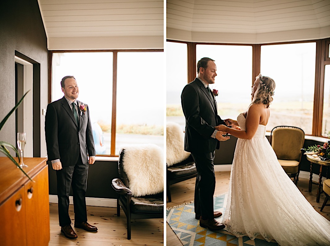 Groom smiles at the bride at their first look during their elopement at the Moher Cliffs