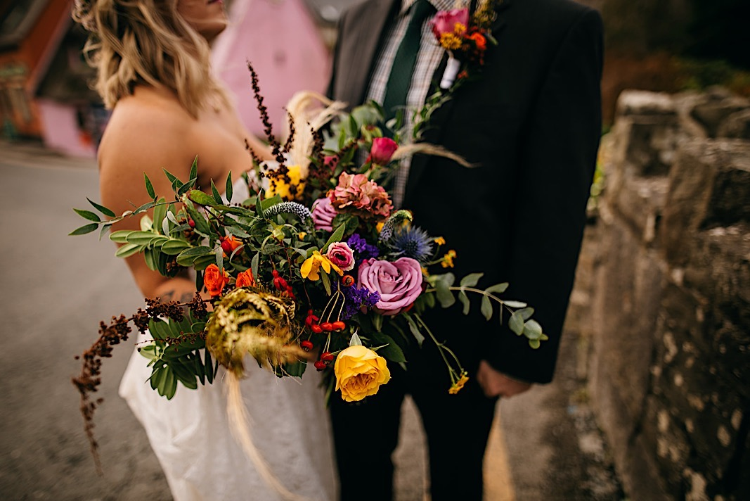 Up close photo of the bride's green, pink and yellow bouquet.