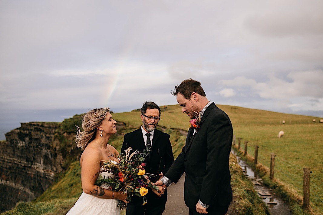 Bride and groom exchange vows on the Moher Cliffs