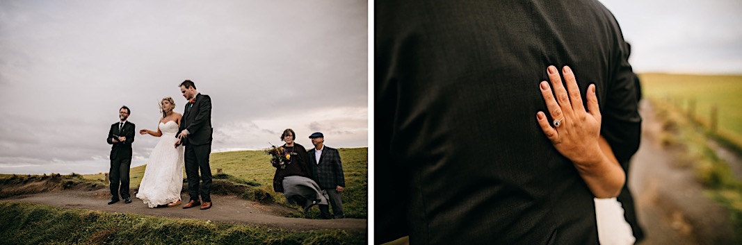 Bride and groom face the cliffside during their engagement photos at the Moher Cliffs