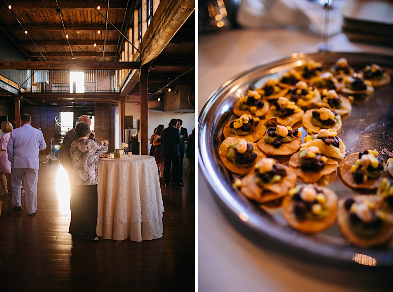 wedding guests stand at a high top table under the tall open-rafter ceilings of The Turnbull Building