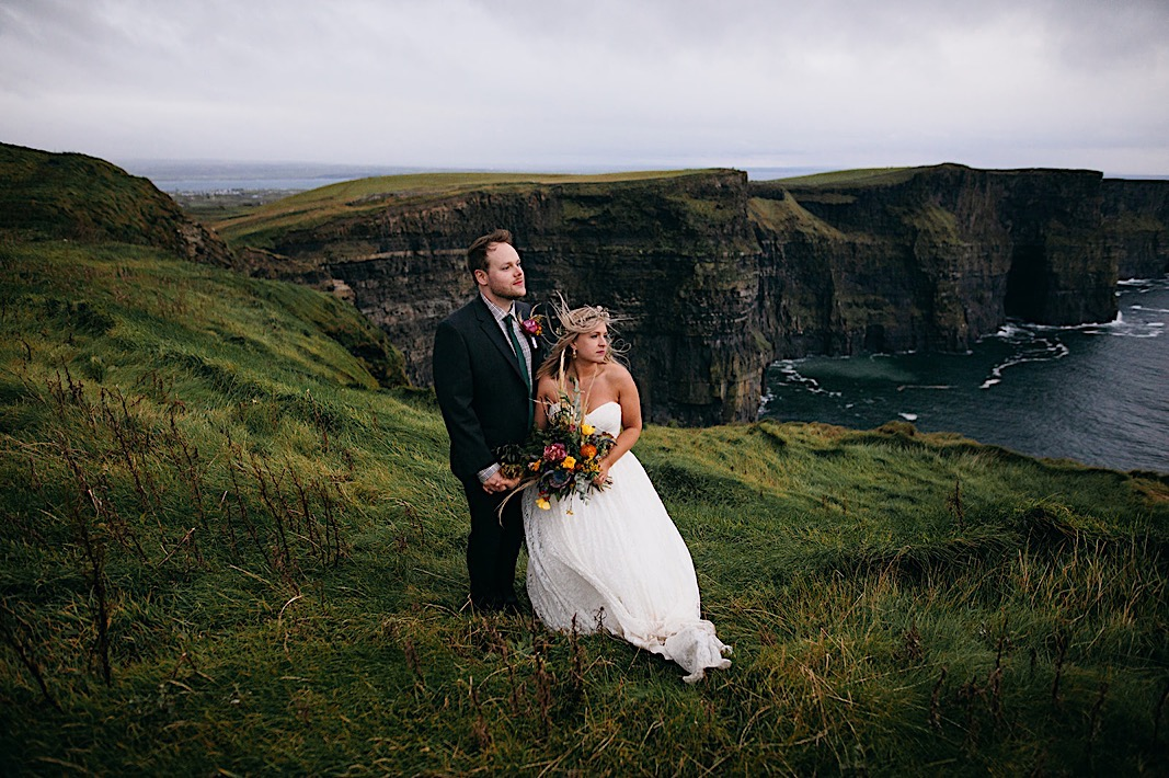 Bride and groom admire the view of the Moher Cliffs