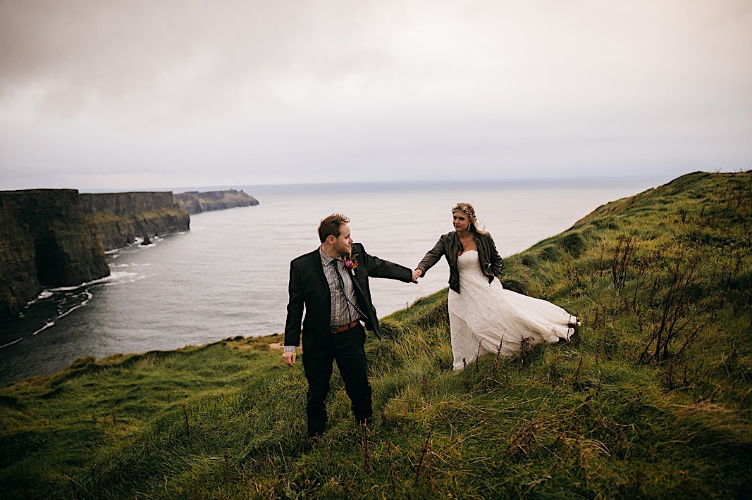 Close up of the bride and grooms rings while holding hands at the Moher Cliffs