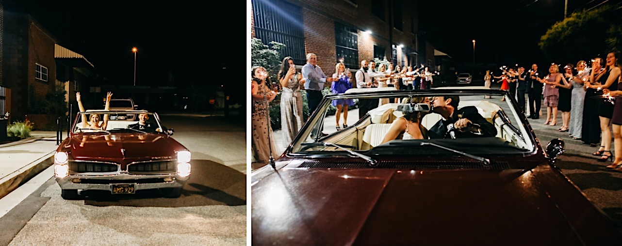 wedding guests cheer as bride and groom kiss in a red antique Pontiac GTO convertible with the top down