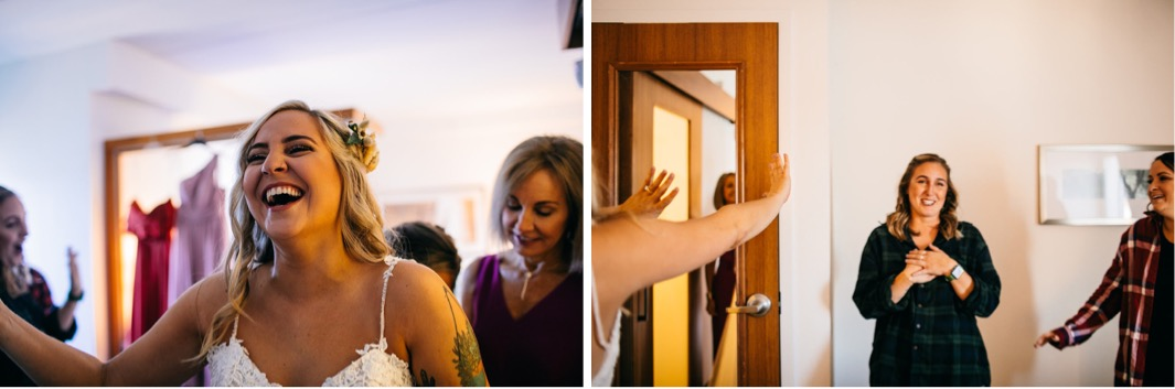 bride laughs while her friends watch her mother fasten her dress
